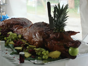 Pig with fruit on table